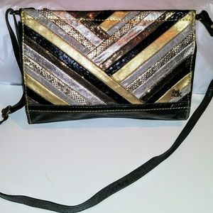 The Sak Black and Metallic Leather Strapped Clutch